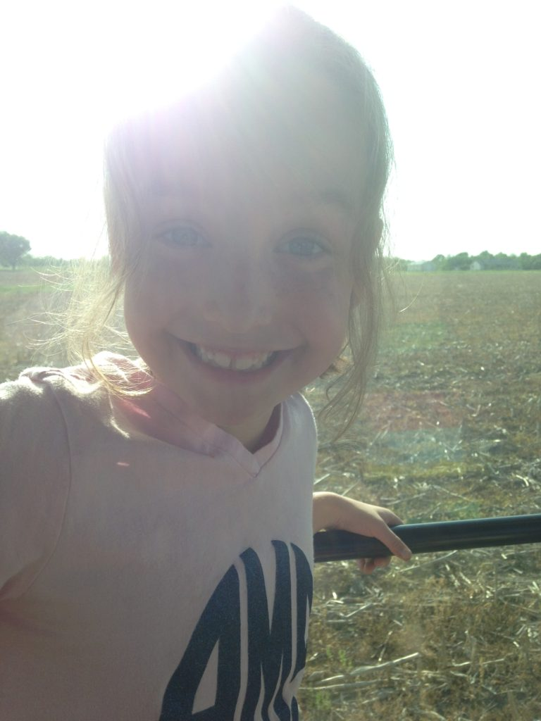Audrey enjoying a little tractor time with Daddy.