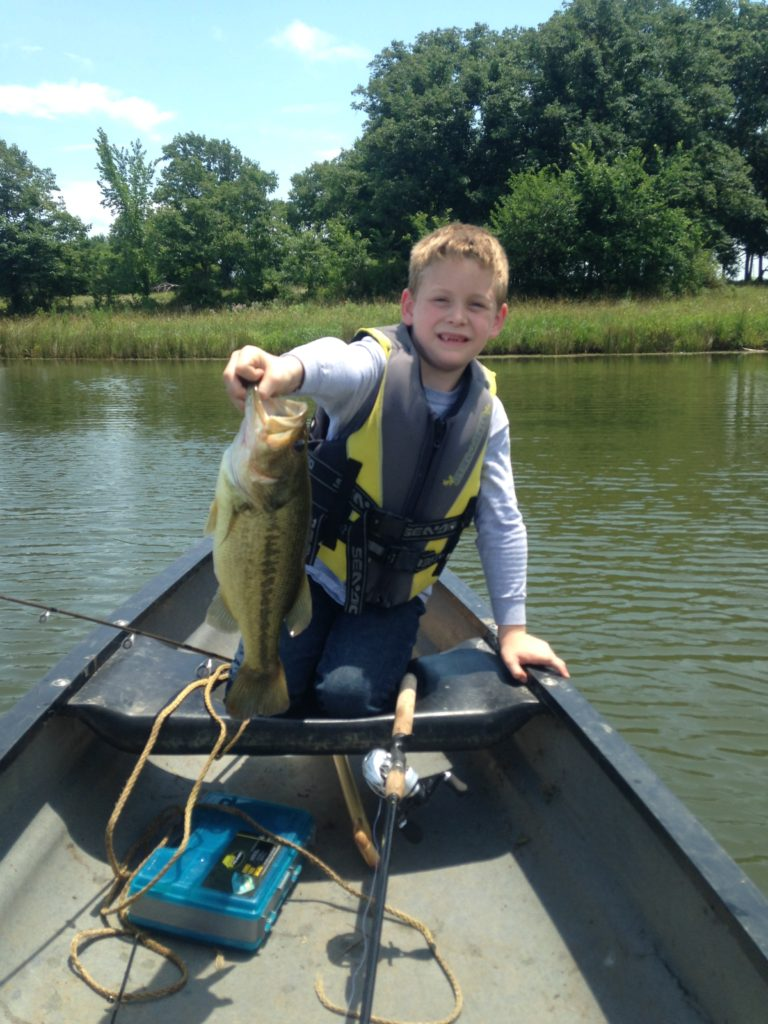 """Matthew breaking several family rules to include: """"no fun,"""" and """"let Dad catch the biggest fish.""""  This was our reward for building fence before a storm."""